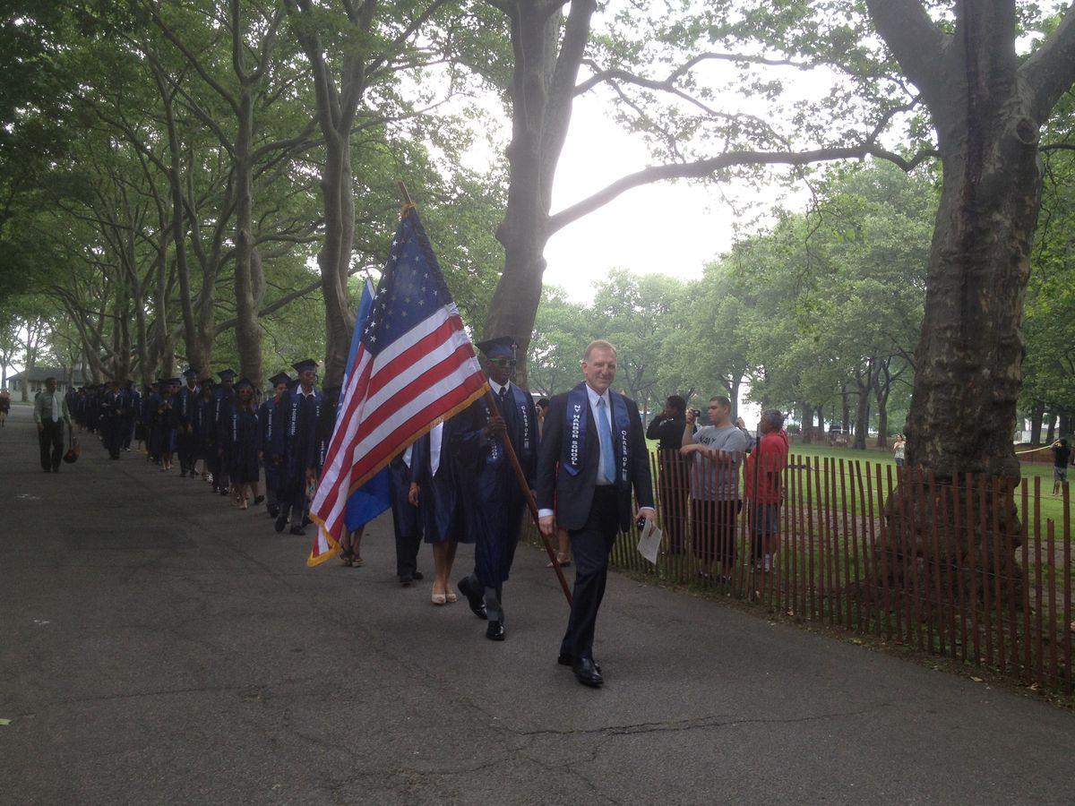 Dudley with the class of 2012 before the ceremony — and the storm.