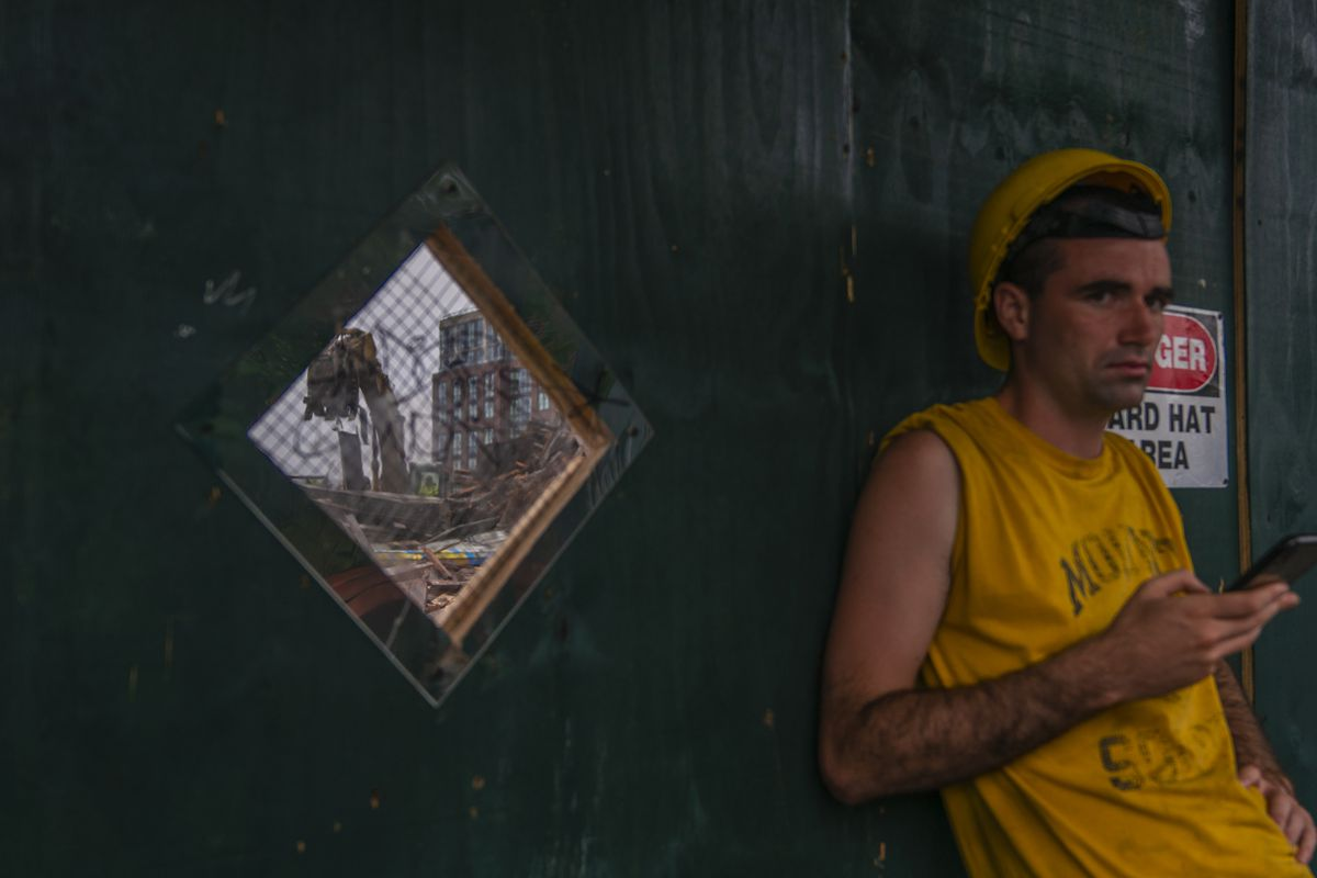 A construction worker leans against a barrier along Union St. in Gowanus on Friday, July 10, 2020.