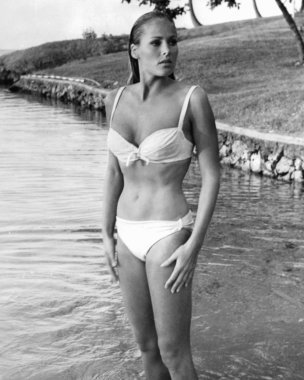 Ursula Andress on the set of Dr. No (left) and Raquel Welch in a publicity  shot for One Million Years B.C. (right). Photos: Getty Images