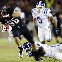 Stanford tight end Zach Ertz, left, is tackled by Duke safety Walt Canty after a 43-yard reception during the first half of an NCAA college football game in Stanford, Calif., Saturday, Sept. 8, 2012.