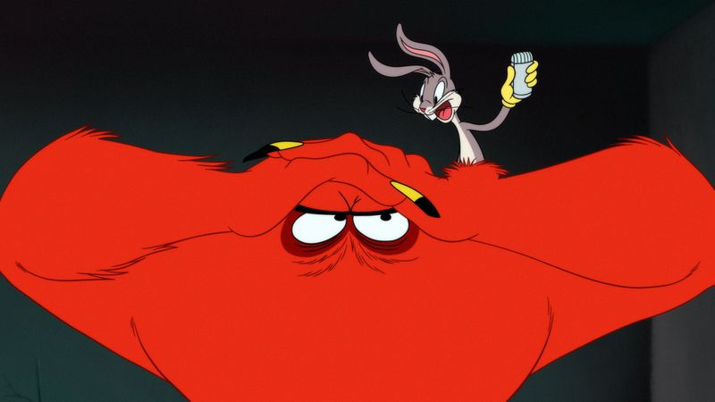 Bugs Bunny hangs out with the big red monster.
