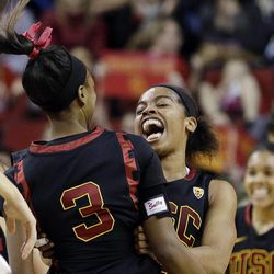 Southern California's Brianna Barrett celebrates with teammates after beating Oregon State in the Pac-12 NCAA college championship basketball game Sunday, March 9, 2014, in Seattle.  USC won 71-62. (AP Photo/Elaine Thompson)