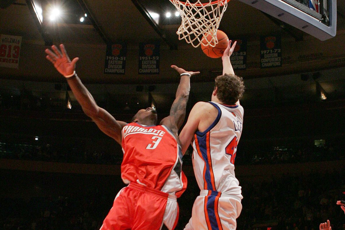 New York Knicks' David Lee tips the ball in on a long inboun