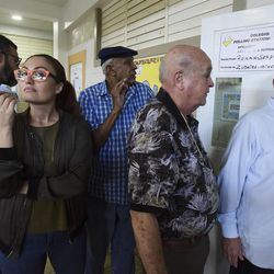 Puerto Rican citizens wait in line to vote during the fifth referendum in San Juan, Puerto Rico, Sunday, June 11, 2017. Residents of the U.S. Territory had to choose between the options of statehood, free association / independence and current territorial status.