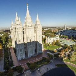 The Salt Lake Temple, left, and the Conference Center, right, prior to the start of the Sunday morning session of the 183rd Semiannual General Conference for The Church of Jesus Christ of Latter-day Saints Sunday, Oct. 6, 2013.