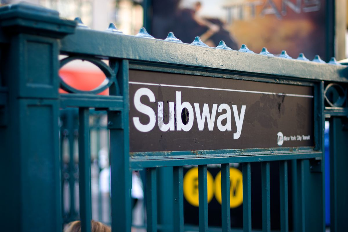 """A sign for New York City's subway that reads """"Subway"""" and is written in white, sans-serif letters in the popular Helvetica typeface."""
