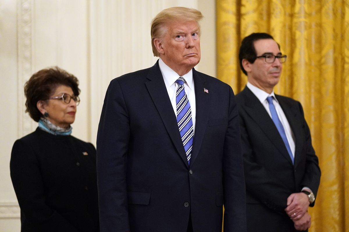 President Donald Trump, along with Jovita Carranza, administrator of the Small Business Administration, and Treasury Secretary Steven Mnuchin.