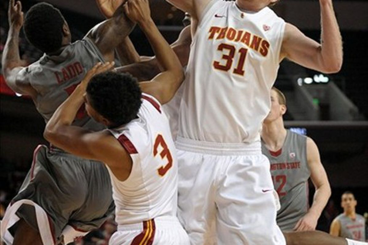 Mar 3, 2012; Los Angeles, CA, USA; Southern California Trojans center James Blasczyk (31) and guard Alexis Moore (3) battle for the ball with guard Mike Ladd (2) at the Galen Center. Mandatory Credit: Kirby Lee/Image of Sport-US PRESSWIRE