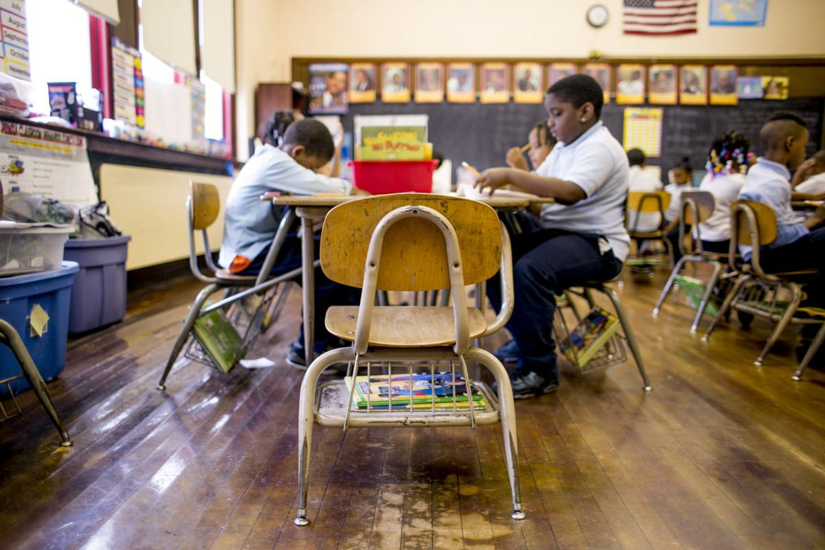 Problems persist at Paul Robeson Malcolm X Academy including a damaged wood floor that teacher Rynell Sturkey worries her students will trip over.