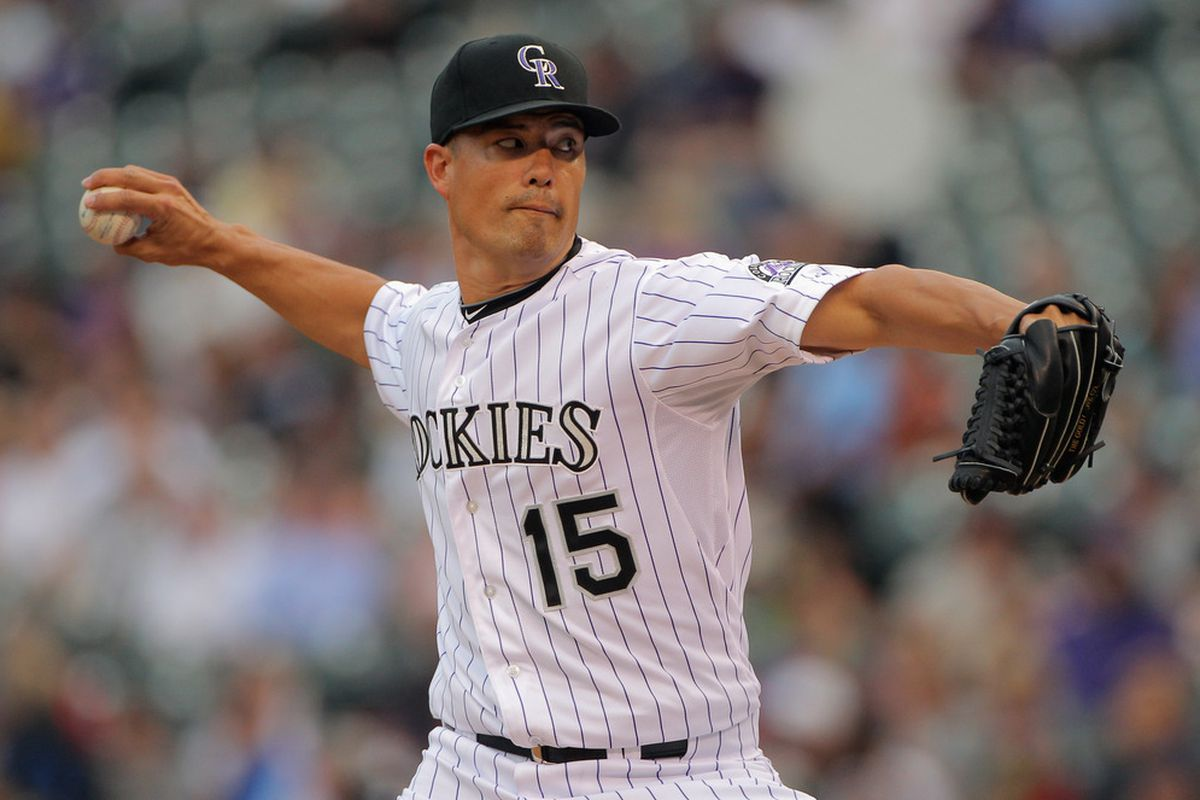 DENVER, CO - JUNE 12:  Starting pitcher Jeremy Guthrie #15 of the Colorado Rockies delivers against the Oakland Athletics during Interleague Play at Coors Field on June 12, 2012 in Denver, Colorado.  (Photo by Doug Pensinger/Getty Images)