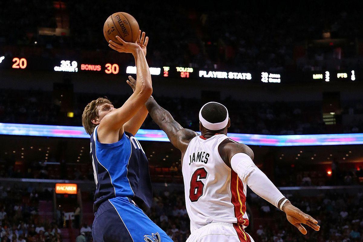 LeBron James defends Dirk Nowitzki.