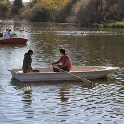 """Rent a rowboat or paddle boat at the <strong>Stow Lake Boathouse</strong> for a romantic shoot on the water. Then round out the session with a few more shots on the bridge and in the Chinese Pavilion. [Photo from <a href=""""http://stowlakeboathouse.com/"""">St"""