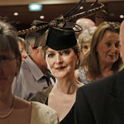 Passengers in evening dress arrive to a reception prior to the gala dinner in the MS Balmoral Titanic memorial cruise ship, in the Atlantic Ocean, Friday, April 13, 2012. Nearly 100 years after the Titanic went down, the cruise with the same number of passengers aboard is setting sail to retrace the ship's voyage, including a visit to the location where it sank. The Titanic Memorial Cruise departed Sunday, April 8, from Southampton, England, where the Titanic left on its maiden voyage and the 12-night cruise will commemorate the 100th anniversary of the sinking of the White Star liner early Sunday, April 15, 2012. AP Photo/Lefteris Pitarakis)