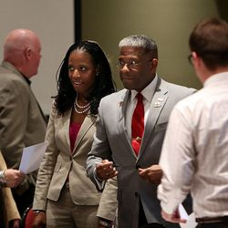 Former Congressman and retired Army Lt. Col. Allen West and congressional hopeful Mia Love chat with guests at a town hall luncheon at Salt Lake Community College's Miller Free Enterprise Conference Center in Sandy on Wednesday, Nov. 13, 2013.