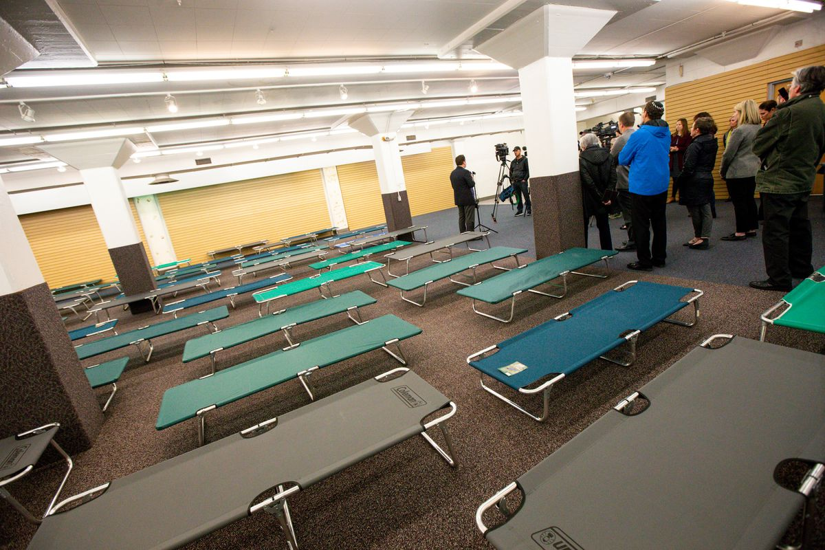 Cots are pictured in the temporary Sugar House homeless shelter in Salt Lake City during a news conference on Thursday, Jan. 23, 2020. The new shelter, which will provide cots, mats and blankets, opened Thursday night.