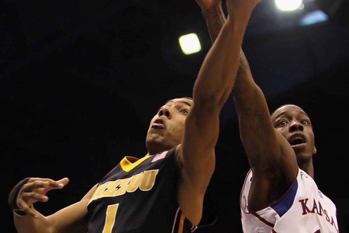 LAWRENCE KS - FEBRUARY 07:  Phil Pressey #1 of the Missouri Tigers battles Tyshawn Taylor #10 of the Kansas Jayhawks for a rebound during the game on February 5 2011 at Allen Fieldhouse in Lawrence Kansas.  (Photo by Jamie Squire/Getty Images)