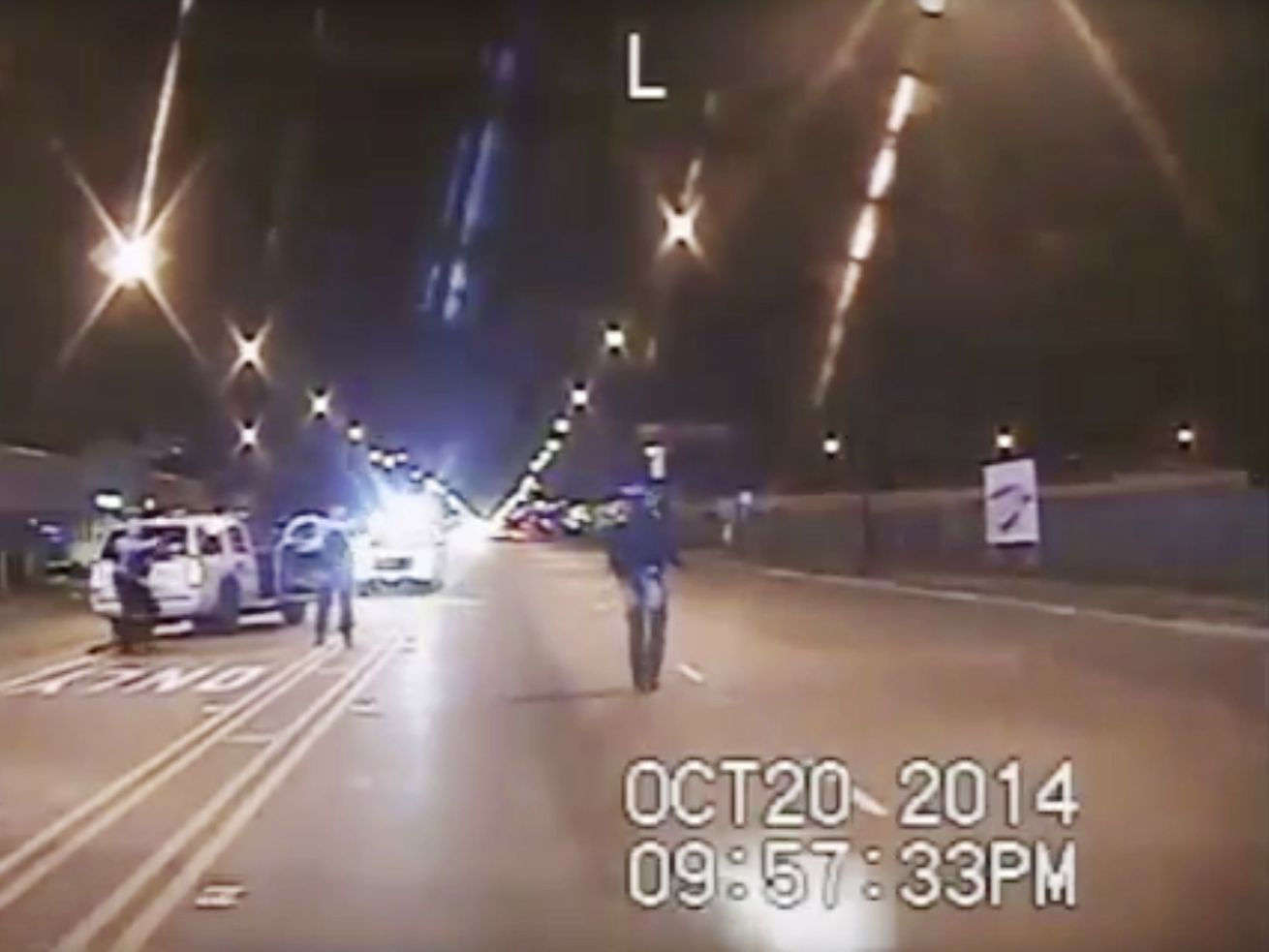 In this Oct. 20, 2014 frame from dash-cam video provided by the Chicago Police Department, Laquan McDonald, right, walks down the street moments before being fatally shot by Officer Jason Van Dyke. The shooting led to a consent decree the department is currently under.