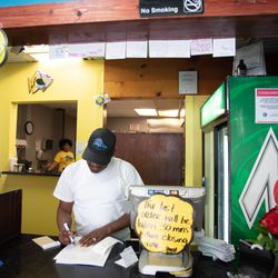 Spencer Coner stands at the counter of Surf's Up South Shore. | Colin Boyle/Sun-Times