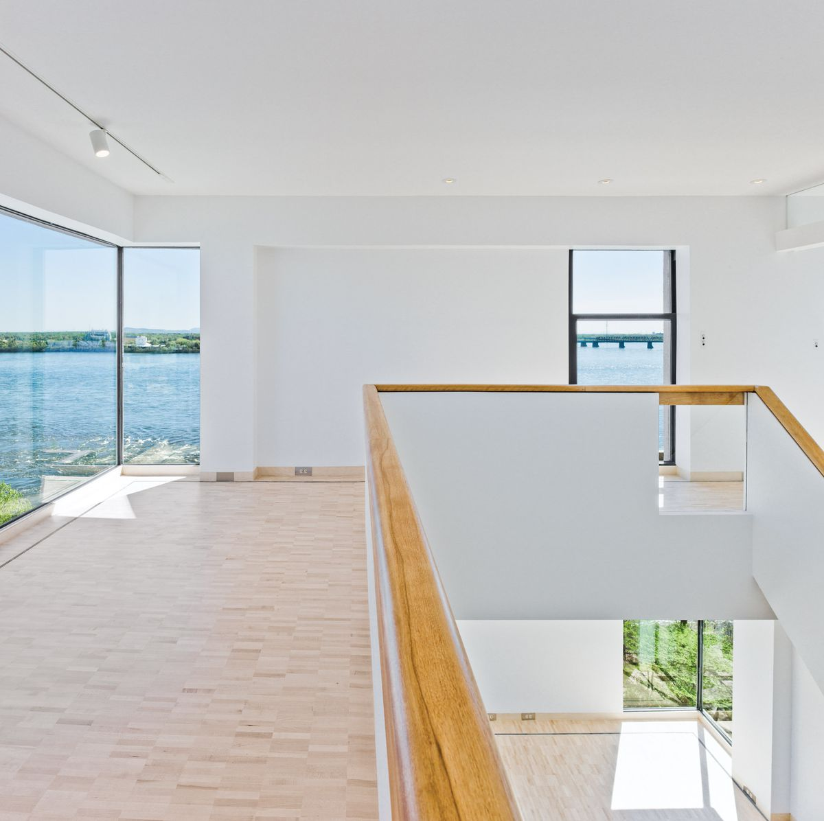 Apartment with wood floors and large windows