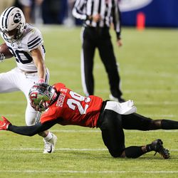 Brigham Young Cougars running back Sione Finau (20) carries the ball against Western Kentucky Hilltoppers defensive back Beanie Bishop (29) during an NCAA football game at LaVell Edwards Stadium in Provo on Saturday, Oct. 31, 2020.