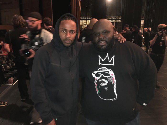 Kendrick Lamar and REVOLT TV's Shaheem Reid.