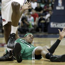 Boston Celtics' Paul Pierce looks for a call from an official after colliding with Atlanta Hawks' Ivan Johnson, left, during the first quarter of Game 1 of an opening-round NBA basketball playoff series, Sunday, April 29, 2012, in Atlanta.