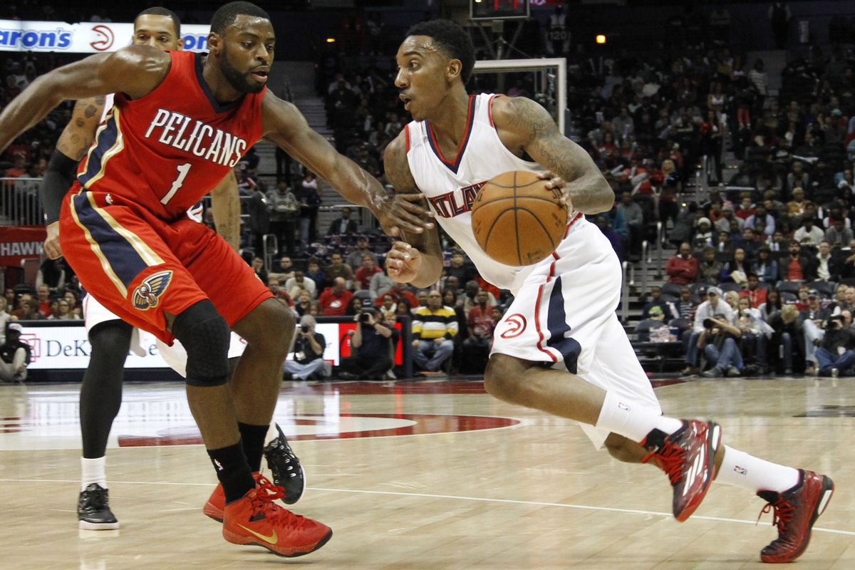 Teague drives past Evans in his Adidas Crazylight Boost