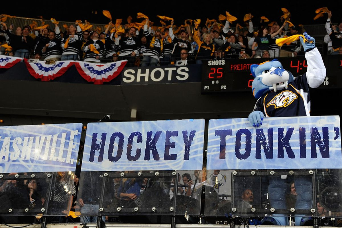 Preds mascot Gnash waves a rally towel to motivate a Bridgestone Arena crowd during Game Three of the Western Conference Quarterfinals against the Anaheim Ducks on April 17, 2011.