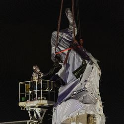 City crews inspect the straps that are around the Christopher Columbus Statue in Grant Park as they begin to remove it, Friday, July 24, 2020.