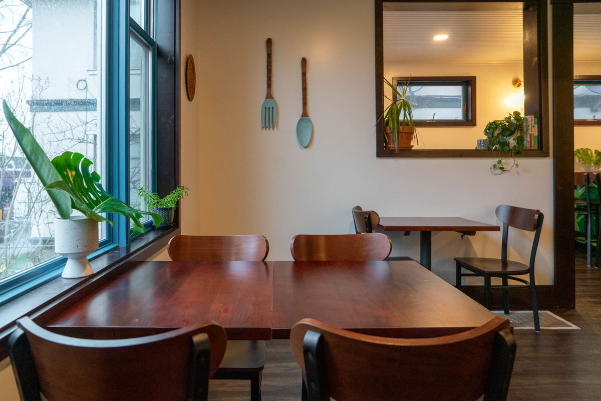 A large fork and spoon hang on the dining room wall at Musang.