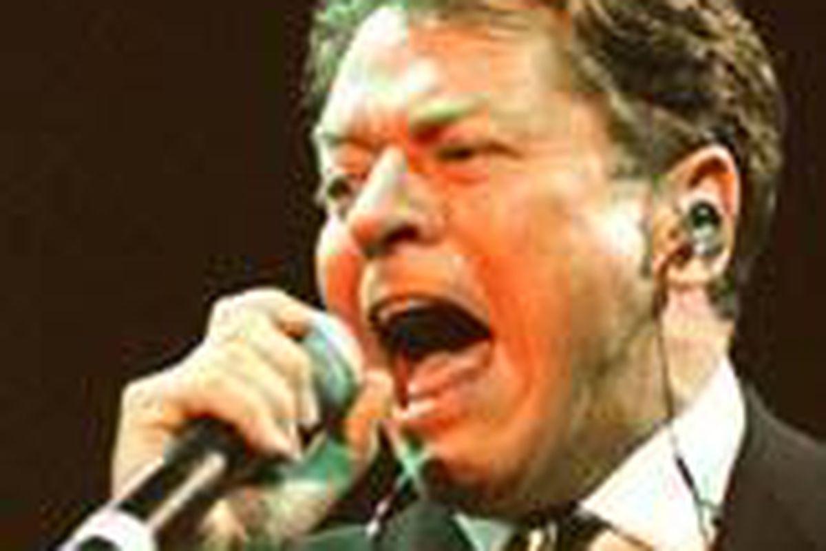 British singer Robert Palmer performs at Wembley Stadium in London in 1997.