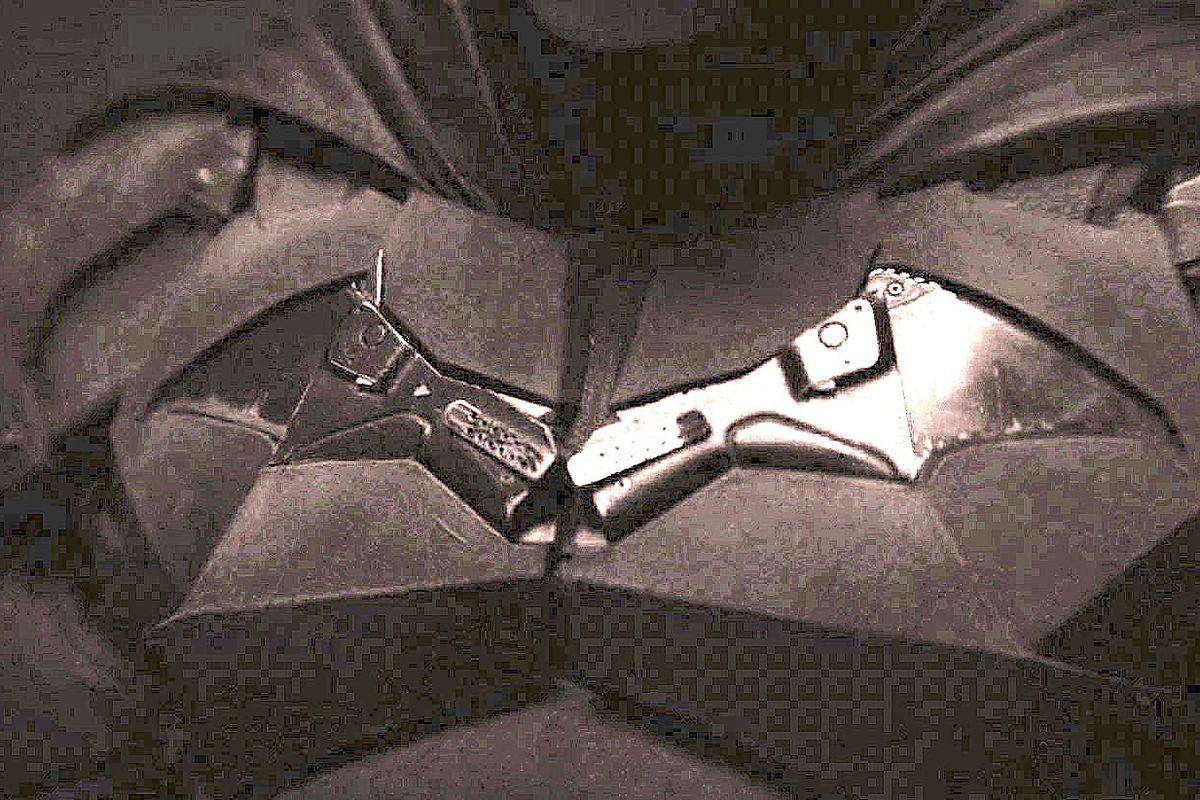 close-up of the bat symbol on robert pattinson's batman costume in the batman