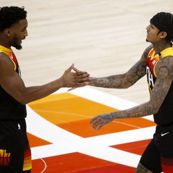 Utah Jazz guard Donovan Mitchell (45) congratulates Utah Jazz guard Jordan Clarkson (00) after Clarkson scored a 3-pointer against the Los Angeles Lakers at Vivint Smart Home Arena in Salt Lake City on Wednesday, Feb. 24, 2021.