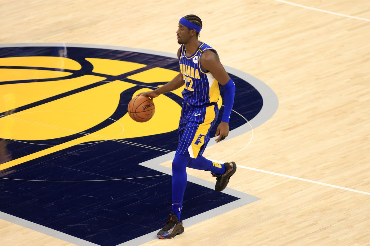 Caris LeVert of the Indiana Pacers brings the ball up the court in the game against the Los Angeles Lakers during the first quarter at Bankers Life Fieldhouse on May 15, 2021 in Indianapolis, Indiana.