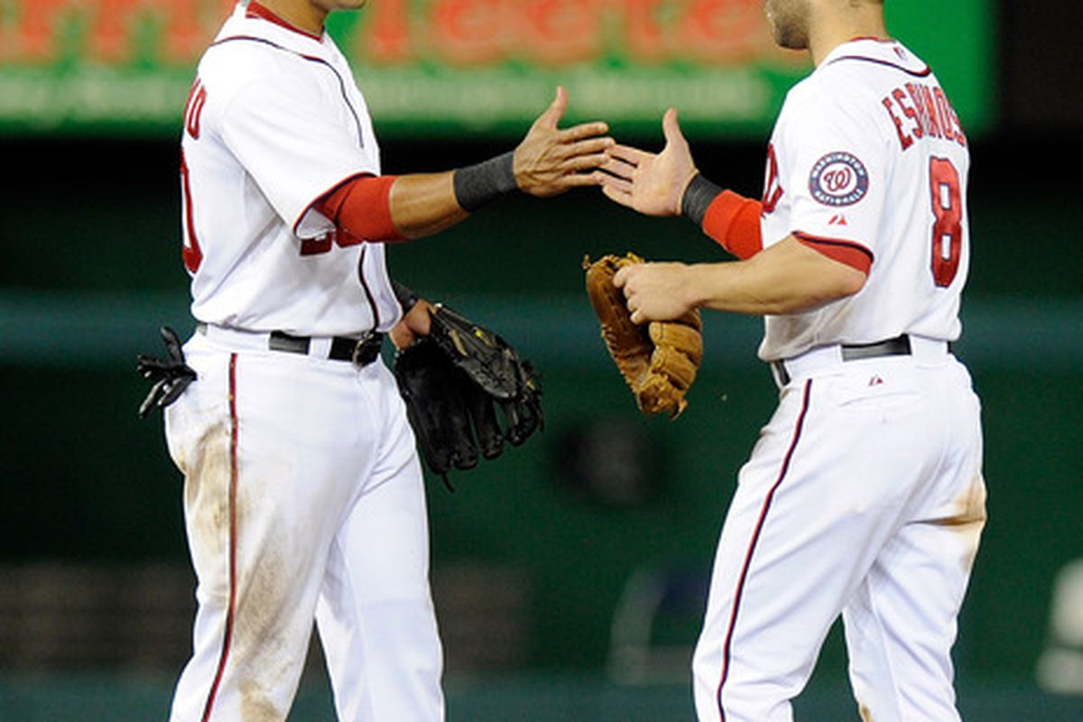 WASHINGTON, DC - JULY 03:  Danny Espinosa #8 and Ian Desmond #20 of the Washington Nationals celebrate after a 9-3 victory against the San Francisco Giants at Nationals Park on July 3, 2012 in Washington, DC.  (Photo by Greg Fiume/Getty Images)