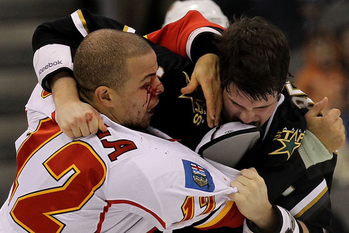 DALLAS TX - DECEMBER 23:  Right wing Jarome Iginla #12 of the Calgary Flames fights with Jamie Benn #14 of the Dallas Stars at American Airlines Center on December 23 2010 in Dallas Texas.  (Photo by Ronald Martinez/Getty Images)