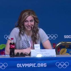 Olympic athlete Noelle Pikus-Pace wears the LDS Young Women torch pendent and medallion around her neck during a press conference at the Winter Olympic games.