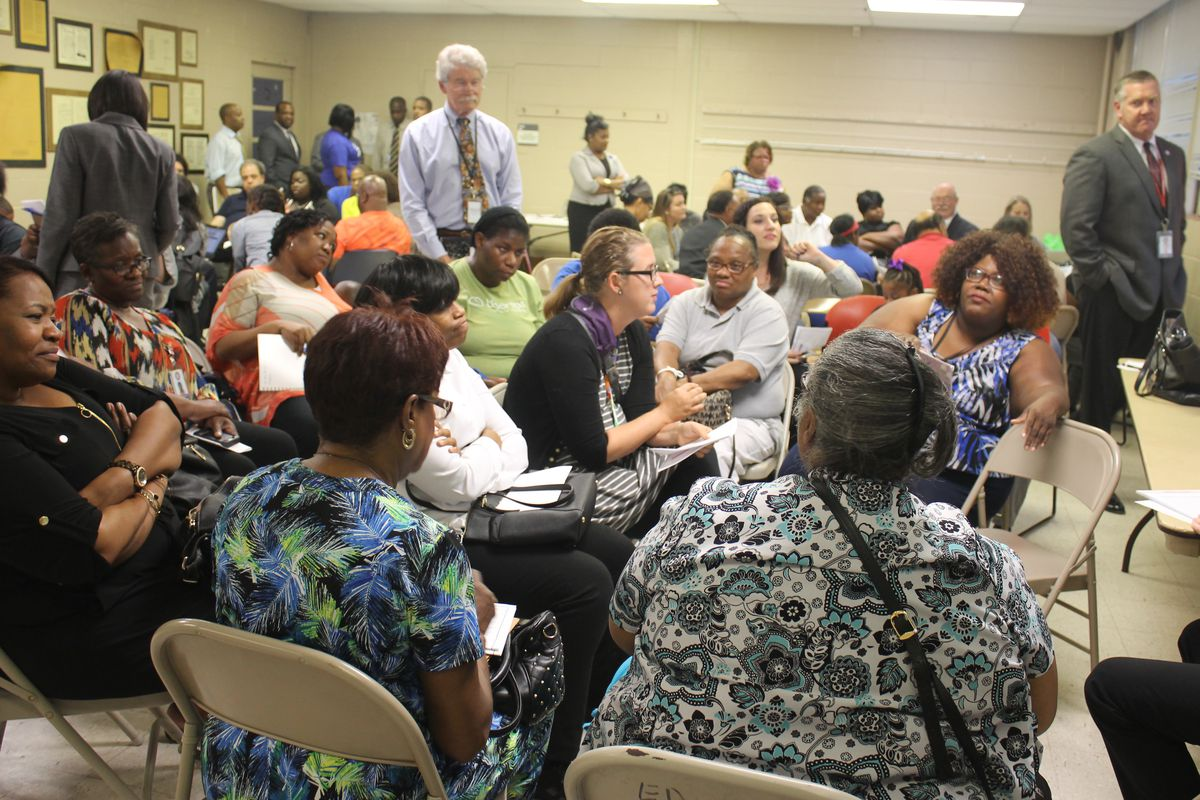 Educators and parents break into small groups during one of nine community meetings held in 2016 to explore the future of Memphis schools.