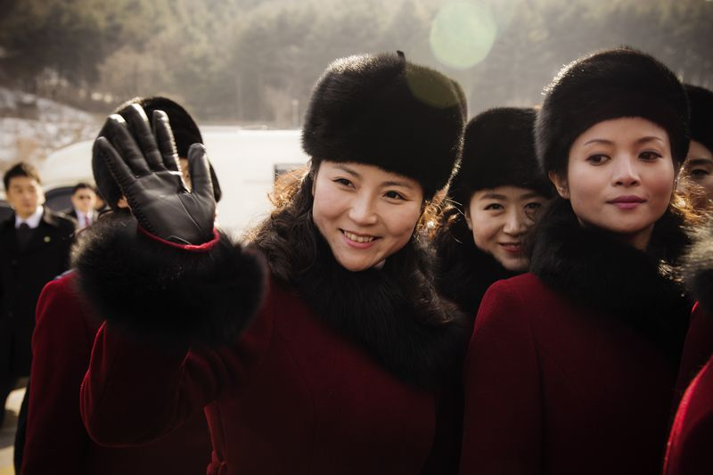 North Korean cheerleaders at a rest stop as their bus convoy carrying a 280-member delegation was on its way to Pyeongchang.
