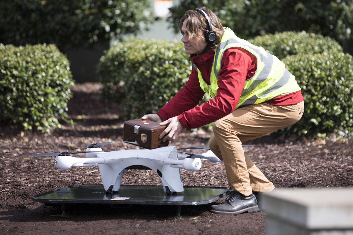 Cesar Serrano, one of Matternet's Part 107 Certified drone operators, retrieves a UPS carriage from the M2 drone on WakeMed's main hospital campus in Raleigh, North Carolina, on Tuesday, March 26, 2019.