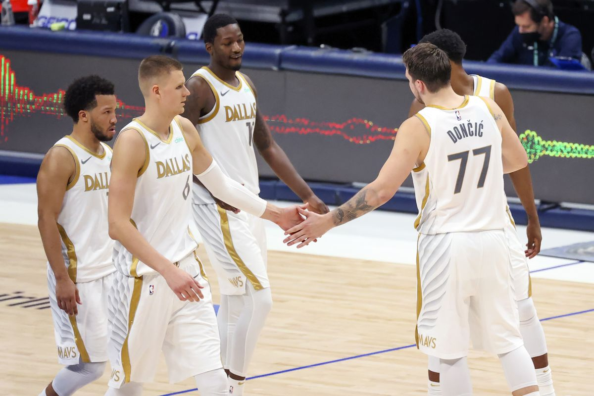 Dallas Mavericks guard Luka Doncic celebrates with teammates during the fourth quarter against the Toronto Raptors at American Airlines Center.