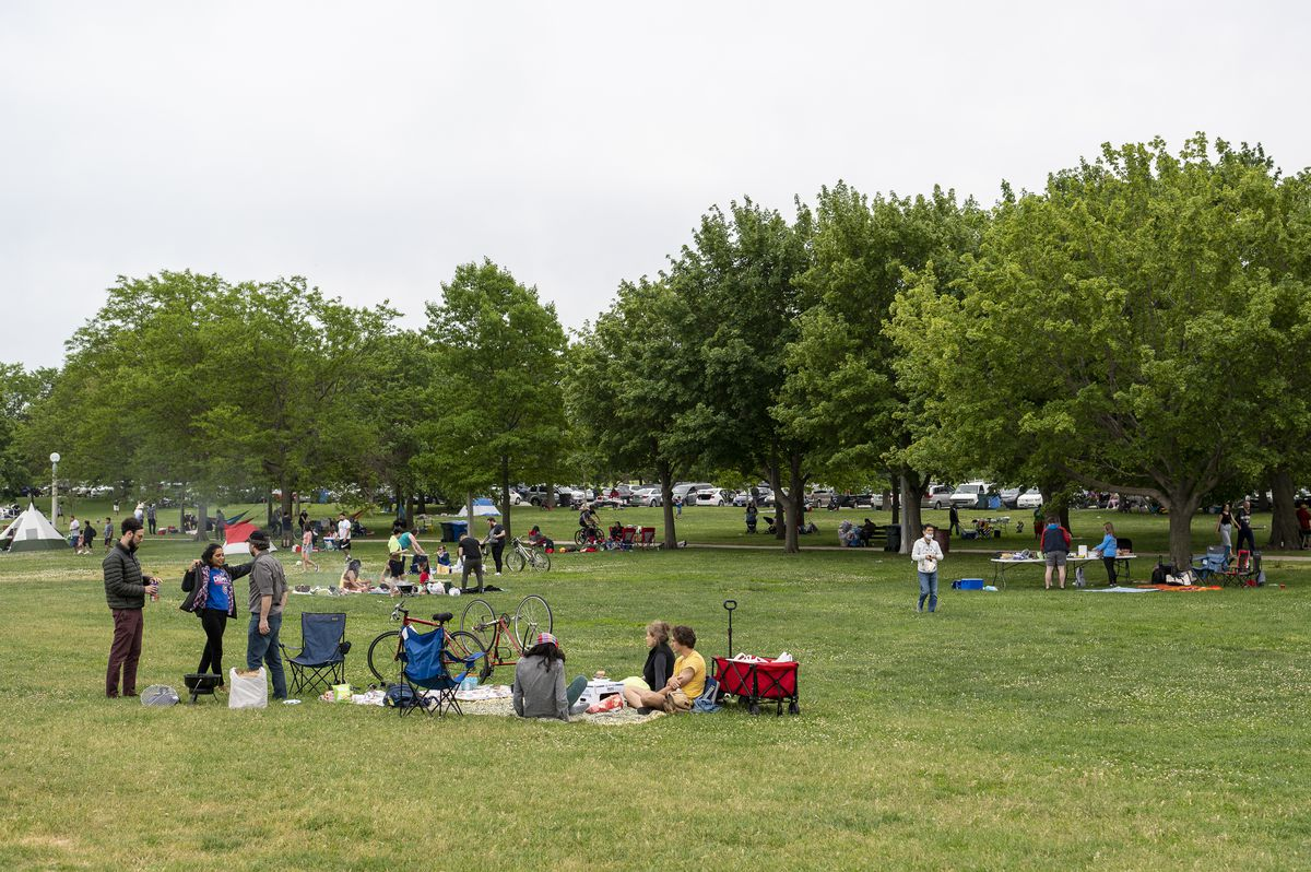 The sand isn't the only lure at Montrose Beach on. Memorial Day; some preferred hanging out on the grass for a picnic on Monday, May 31, 2021.
