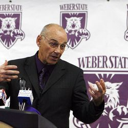John L. Smith answers questions as he is introduced as the new head football coach at Weber State University in Ogden, Tuesday, Dec. 6, 2011.