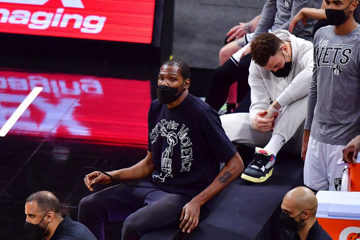 Kevin Durant of the Brooklyn Nets looks on from the bench during the second half against the Orlando Magic at Amway Center on March 19, 2021 in Orlando, Florida.