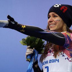 Noelle Pikus-Pace of the United States cries during the flower ceremony after winning the silver medal during the women's skeleton competition at the 2014 Winter Olympics, Friday, Feb. 14, 2014, in Krasnaya Polyana, Russia. (AP Photo/Dita Alangkara)