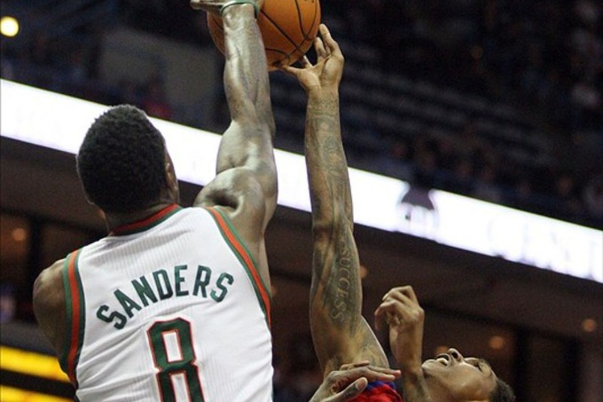 March 5, 2012; Milwaukee, WI, USA; Milwaukee Bucks forward Larry Sanders (8) blocks a shot from Philadelphia 76ers guard Louis Williams (23) during the first half at the Bradley Center. Mandatory Credit: Mary Langenfeld-US PRESSWIRE