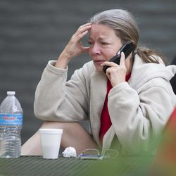 Nancy Myers is emotional as she speaks to her boss to let him know that she won't be able to make it into work due to the Yarnell Hill Fire on Monday, July 1, 2013, at the Red Cross Shelter in Prescott, Ariz. The wildfire destroyed 200 houses in the town of Yarnell and the nearby community of Glen Isla. Nineteen firefighters from an elite crew from Prescott were killed in the blaze.