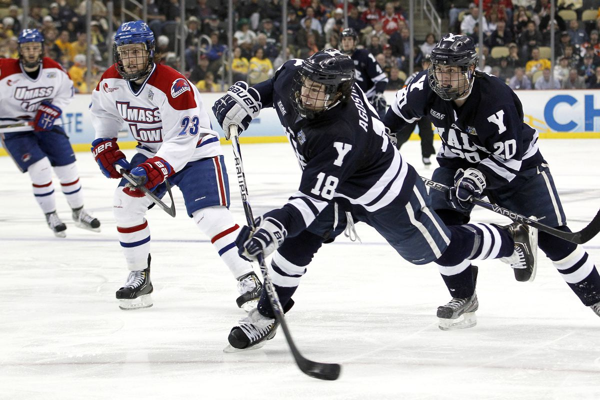 Yale's Kenny Agostino fires a shot on net during the 2013 NCAA Frozen Four in Pittsburgh.