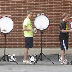 Members of the American Fork High Marching Band drum line practice for the funeral of American Fork High band instructor Heather Christensen, who was killed in a bus accident on their way back from a band competition in Idaho over the weekend.
