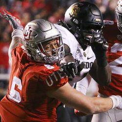 Utah Utes defensive end Bradlee Anae (6) is shoved back by Colorado Buffaloes offensive lineman Arlington Hambright (51) after a pair of Utes sacked the Colorado quarterback during the second half of an NCAA football game at Rice-Eccles Stadium in Salt Lake City on Saturday, Nov. 30, 2019. Several players began to scuffle following the play triggering offsetting personal fouls.